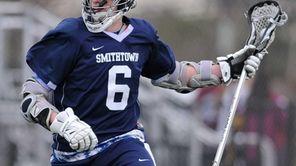 Smithtown West's Ryan Keenan circles behind the net