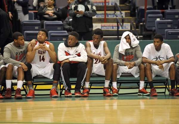 Long Island Lutheran players react to a 58-52