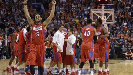 Dayton's Devin Oliver (5) celebrates with teammates after