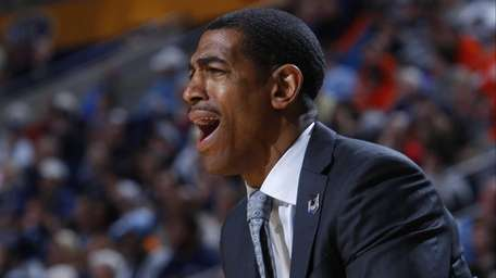 Connecticut coach Kevin Ollie calls out to his