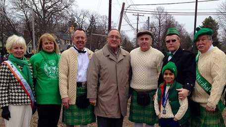 The Farmingdale village board poses with 2014 Empire