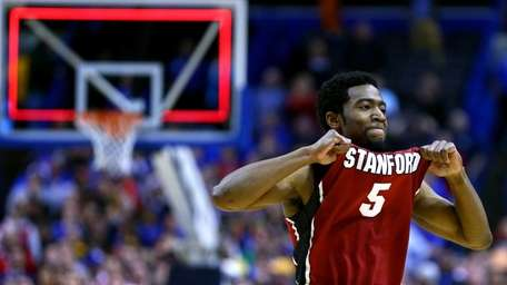 Chasson Randle #5 of the Stanford Cardinal celebrates