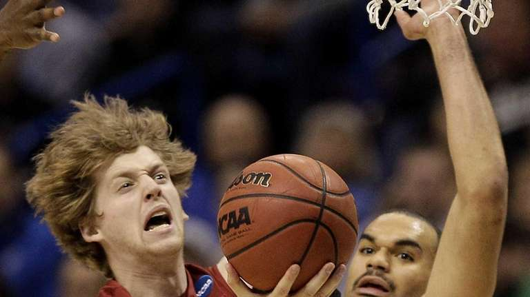 Stanford's John Gage shoots under pressure from Kansas's