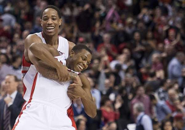 Toronto Raptors teammates DeMar DeRozan, left, and Kyle