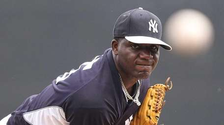 Michael Pineda delivers a pitch in the third