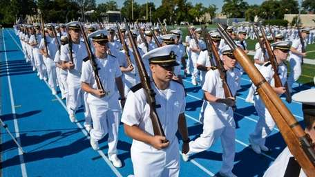 Midshipmen march down Brooks stadium during the viewing