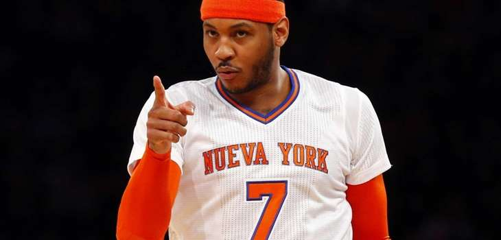 Carmelo Anthony reacts after a three-point basket in