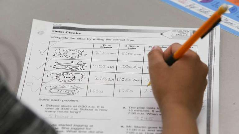 3rd-grade students study time and clocks in a