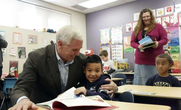 Indiana Republican Gov. Mike Pence embraces a preschool