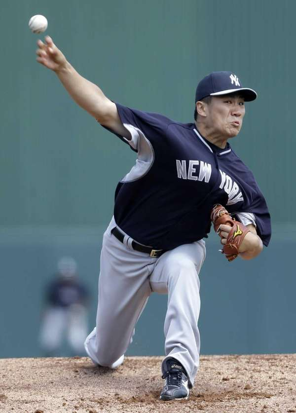 Masahiro Tanaka pitches in the first inning of