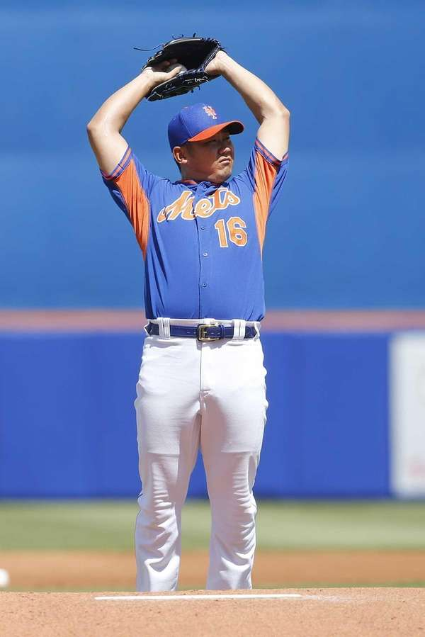 Daisuke Matsuzaka stretches behind the mound before the