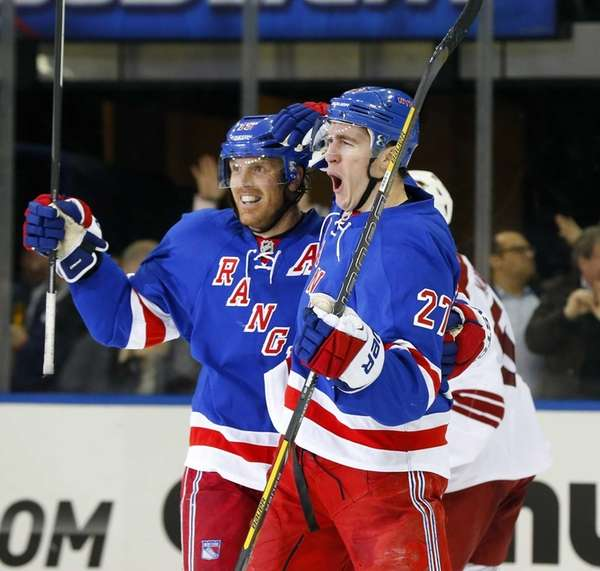 Ryan McDonagh celebrates his overtime goal against the