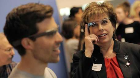 Ilyane Morden Kichaven, right, gets a Google Glass