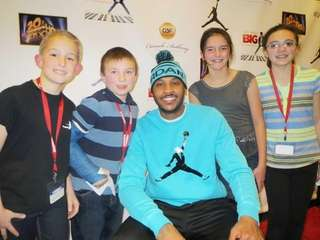 New York Knicks forward Carmelo Anthony with Kidsday