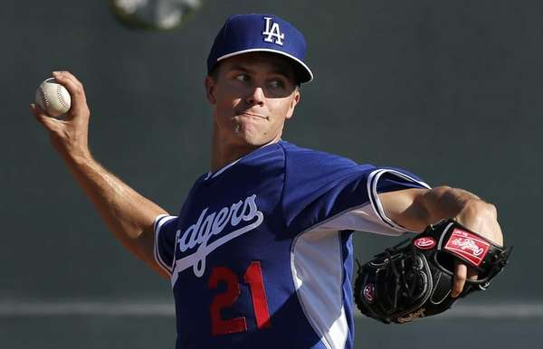Los Angeles Dodgers pitcher Zack Greinke delivers a