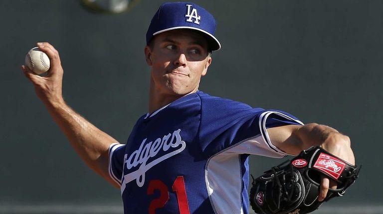 Los Angeles Dodgers pitcher Zack Greinke delivers a
