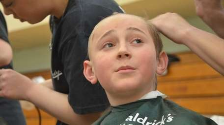Sixth-grader Alex Lessman, 11, of Plainview, and 23