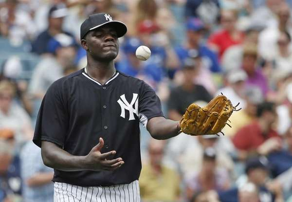 Michael Pineda tosses the ball after allowing a
