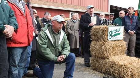 Farmers look on as Long Island Farm Bureau