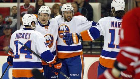 Islanders' Colin McDonald center, celebrates his goal with