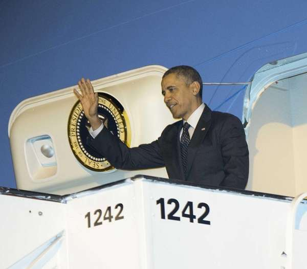 President Barack Obama waves upon his arrival on