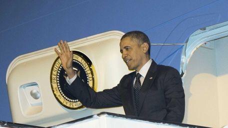 President Barack Obama waves upon his arrival on