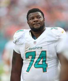 Miami Dolphins offensive guard John Jerry looks up