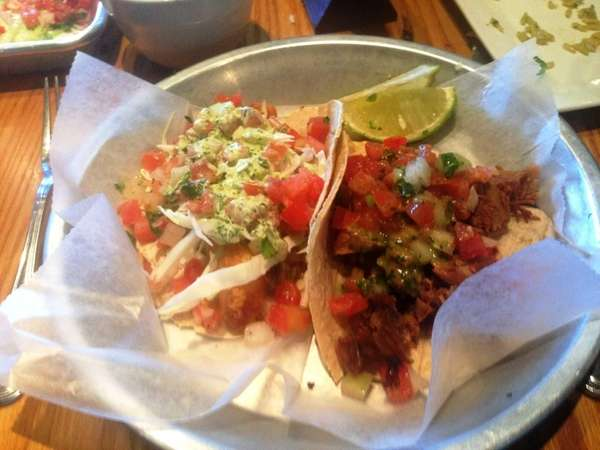 Fish taco and pork carnita taco at Pico