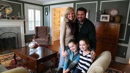 Kate and Anthony Trani with their daughters Mia,
