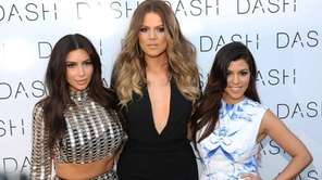 Kim Kardashian, Khloe Kardashian and Kourtney Kardashian attend
