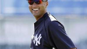 Derek Jeter smiles before a spring training game