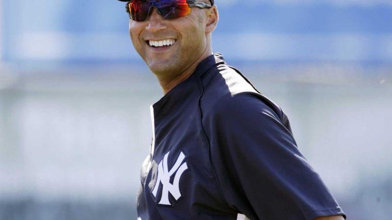 Derek Jeter smiles before a spring training game