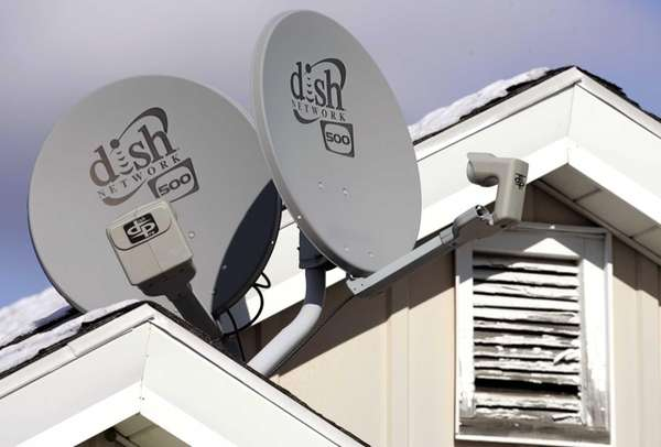 Dish Network Corp. satellite dishes are attached to