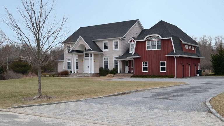 Surrounded by 25 acres of preserved wooded land,