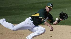 Oakland Athletics third baseman Josh Donaldson fields a