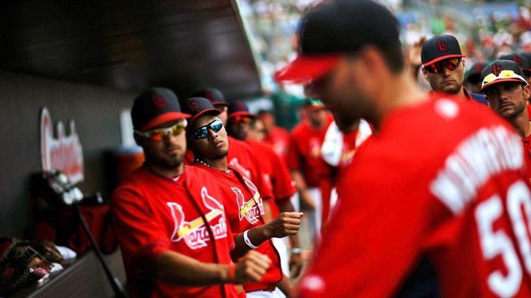 Teammates wait to fist-bump St. Louis Cardinals starting