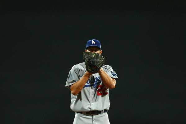 Los Angeles Dodgers pitcher Clayton Kershaw prepares to