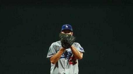 Los Angeles Dodgers pitcher Clayton Kershaw prepares to
