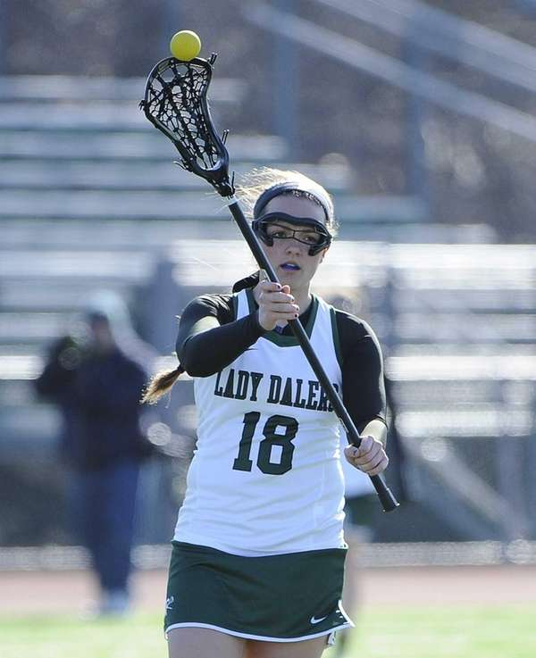 Farmingdale's Bridget Weill passes the ball against Massapequa