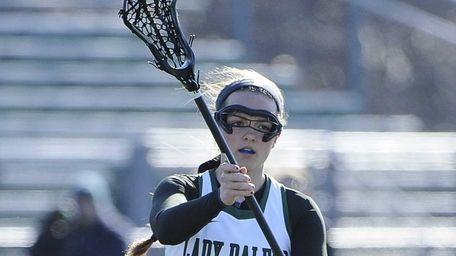 Farmingdale's Bridget Weill passes the ball against Massapequa