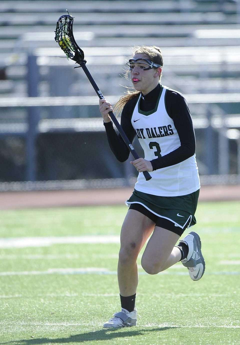 Farmingdale's Emily Marlow controls the ball against Massapequa