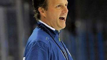 Tampa Bay Lightning head coach Jon Cooper watches