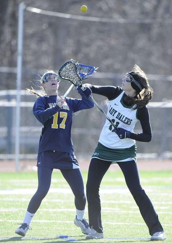 Farmingdale's Chrissy Kelly takes the draw against Massapequa's