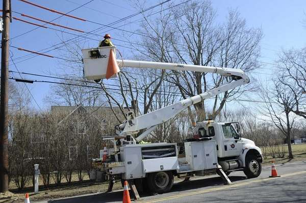 Workers replace poles with taller ones on Toilsome