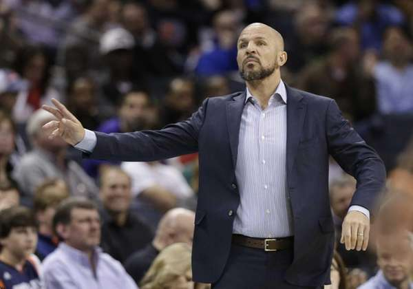 Jason Kidd talks to his players during the