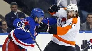 Marc Staal of the Rangers defends against Sean