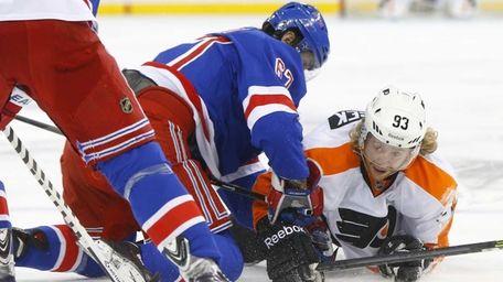 Benoit Pouliot of the Rangers fall onto Jakub