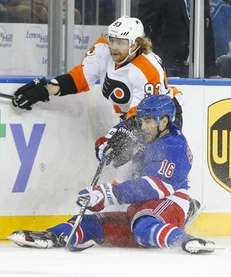 Derick Brassard of the Rangers checks Jakub Voracek