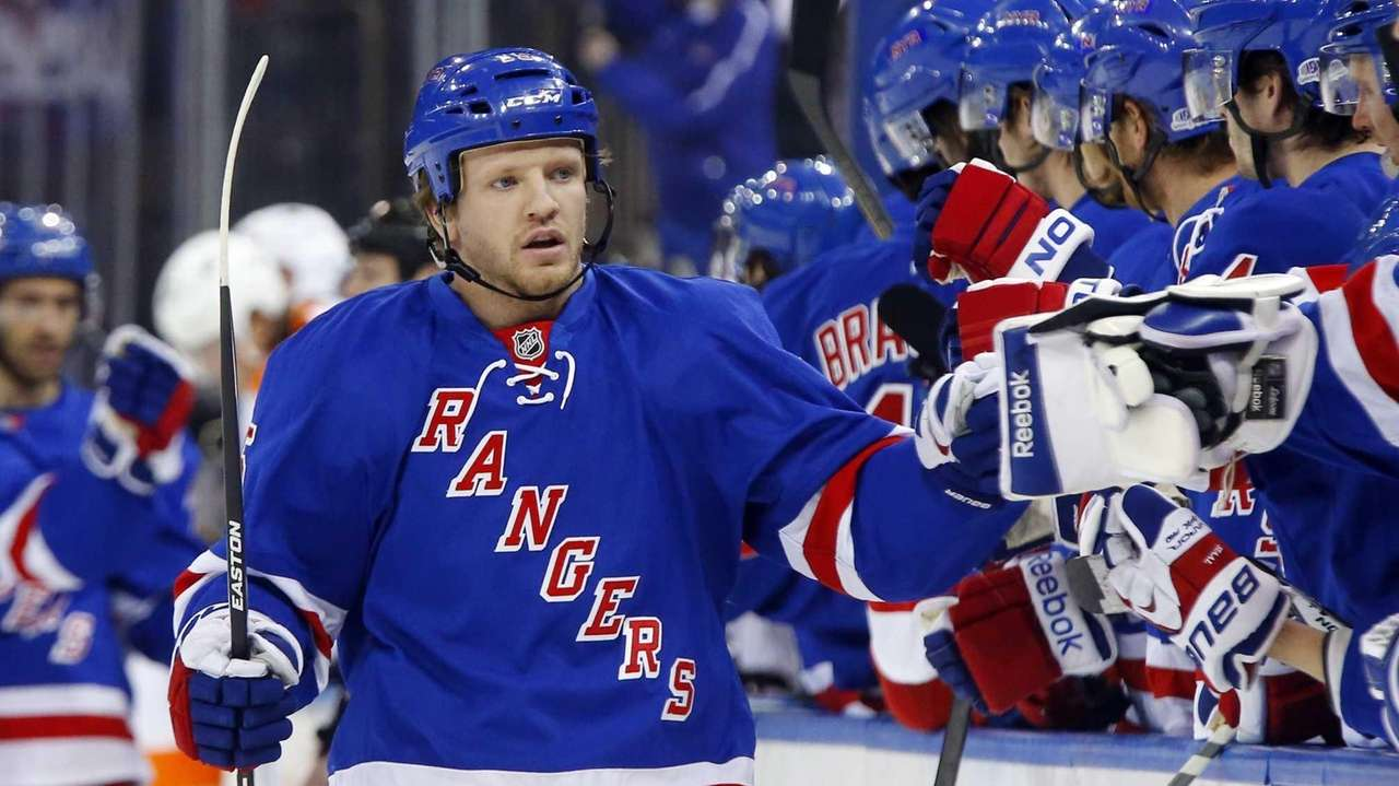 Derek Dorsett of the Rangers celebrates his first