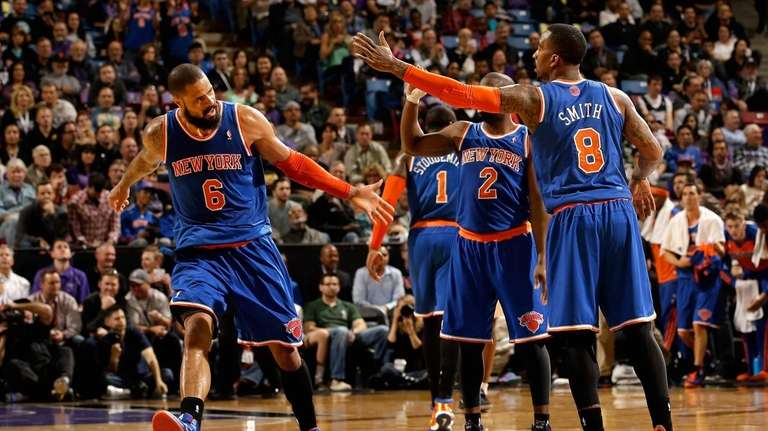 Tyson Chandler is congratulated by J.R. Smith of
